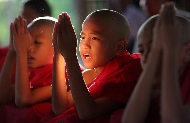 Buddhist novice monk child in red robe in Burma (Myanmar)