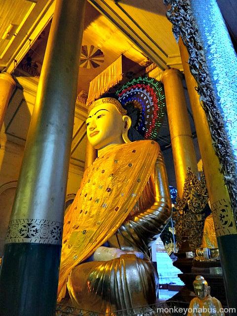 golden Buddhist statue at Shwedagon Pagoda in Yangon, Myanmar