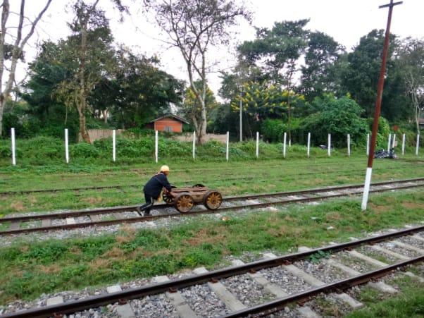 Shan man working on the railroad near Pyin Oo Lwin in Shan State, Myanmar