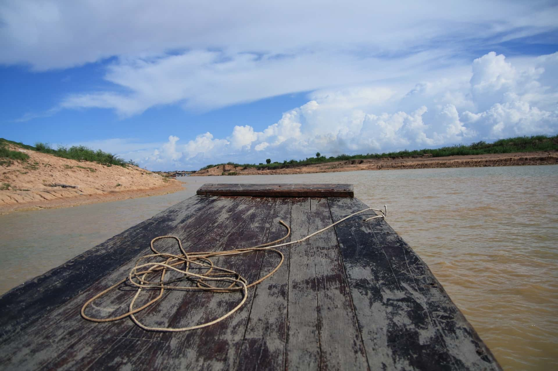 old wooden raft on a river in Cambodia